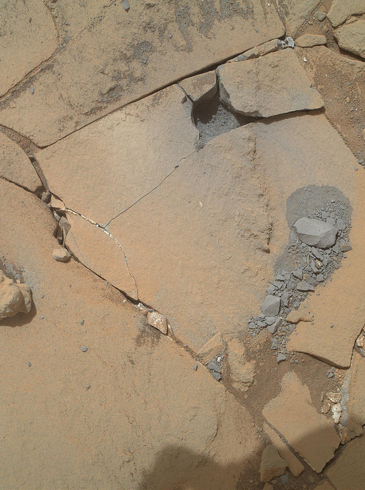 "This Jan. 13, 2015, view from the Mars Hand Lens Imager on NASA's Curiosity Mars rover shows outcomes of a mini-drill test to assess whether the ""Mojave"" rock is appropriate for full-depth drilling to collect a sample. Cracking of the rock has made freshly exposed surfaces available for inspection."