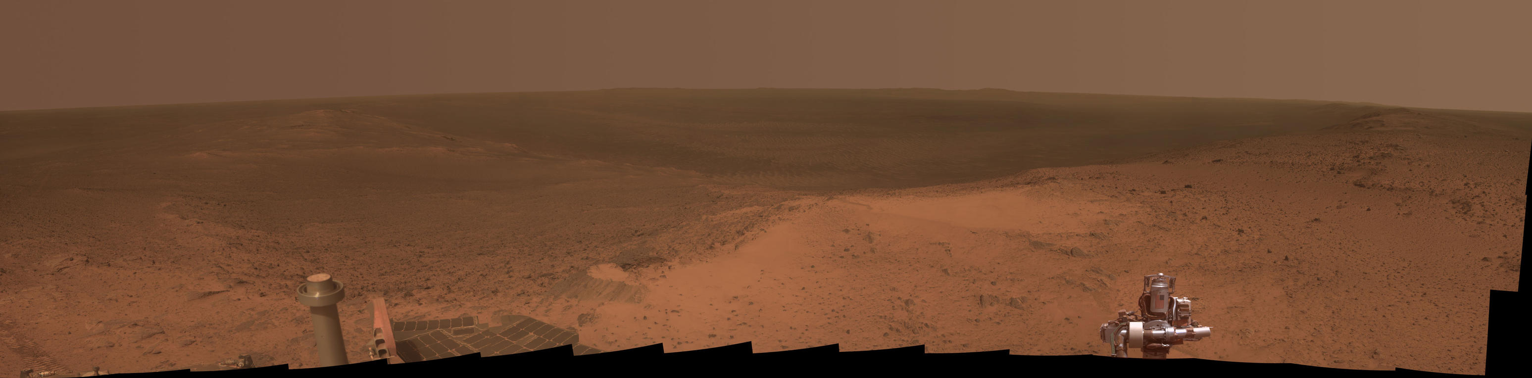"This panorama is the view NASA's Mars Exploration Rover Opportunity gained from the top of the ""Cape Tribulation"" segment of the rim of Endeavour Crater. The rover reached this point three weeks before the 11th anniversary of its January 2004 landing on Mars."