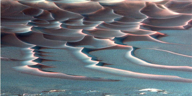 "As NASA's Mars Exploration Rover Opportunity creeps farther into ""Endurance Crater,"" the dune field on the crater floor appears even more dramatic"