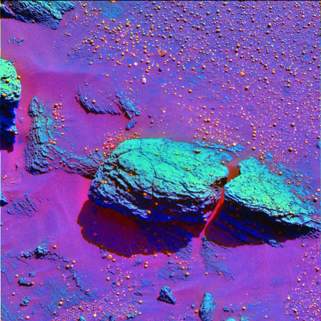 This false-color image taken by the panoramic camera onboard the Mars Exploration Rover Opportunity highlights the spherules that speckle the rock dubbed Stone Mountain