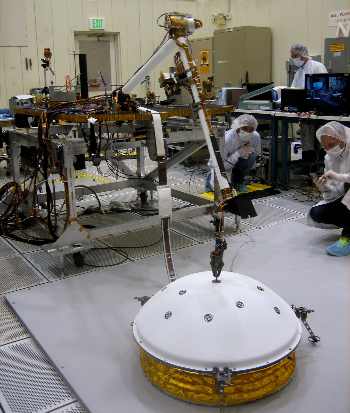 This image shows testing of InSight's robotic arm at JPL about two years before it will perform these tasks on Mars.
