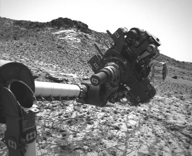 This March 4, 2015, image from the Navcam on NASA's Curiosity Mars rover shows the position in which the rover held its arm for several days after a transient short circuit triggered onboard fault-protection programming to halt arm activities on Feb. 27.