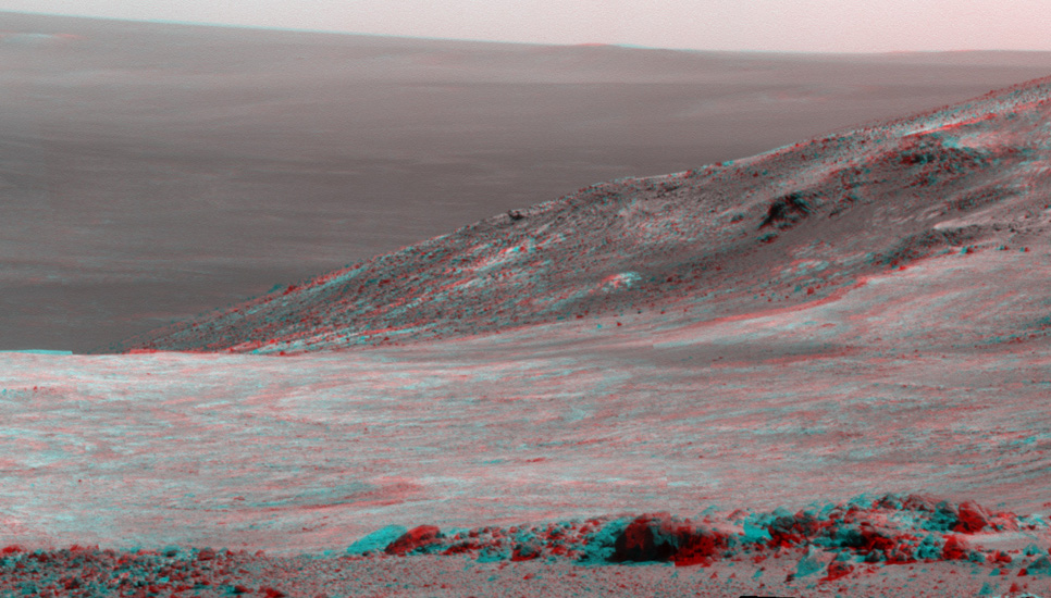 "This stereo scene from NASA's Mars Exploration Rover Opportunity shows part of ""Marathon Valley,"" a destination on the western rim of Endeavour Crater, as seen from an overlook north of the valley."