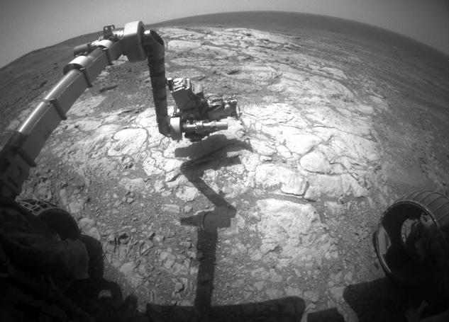 "NASA's Mars Exploration Rover Opportunity has extended its robotic arm for studying a light-toned rock target called ""Athens"" in this March 25, 2015, image from the rover's front hazard avoidance camera."