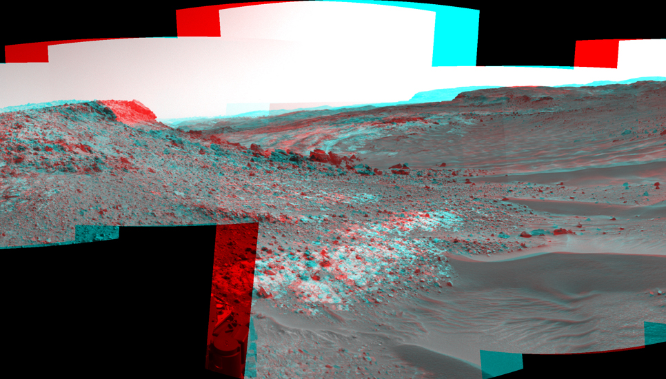 "This stereo view from the Navigation Camera (Navcam) on NASA's Curiosity Mars rover shows the terrain ahead of the rover as it makes its way westward through a valley called ""Artist's Drive."""
