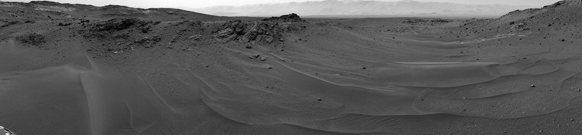 NASA's Curiosity Mars rover used its Navigation Camera (Navcam) to capture this scene toward the west just after completing a drive that took the mission's total driving distance past 10 kilometers (6.214 miles).