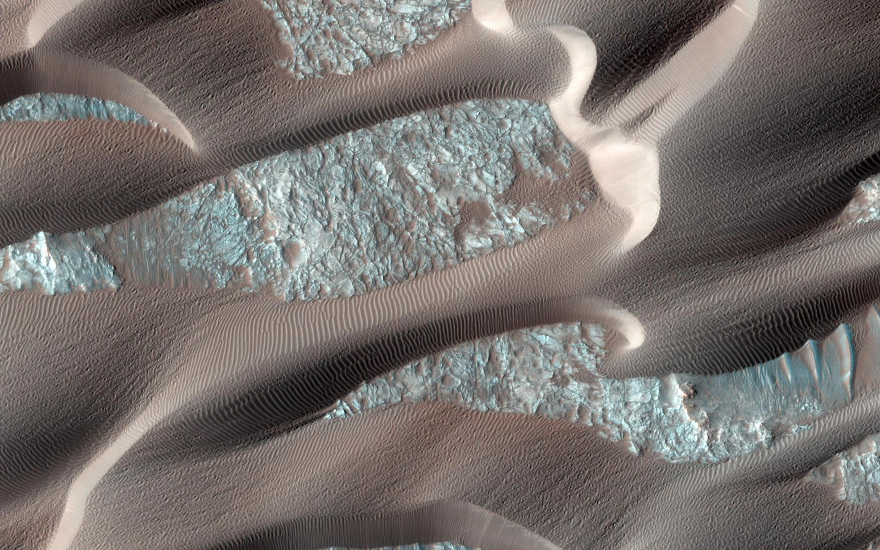 This image shows, smooth dark dunes, with lighter gray sand in between them.