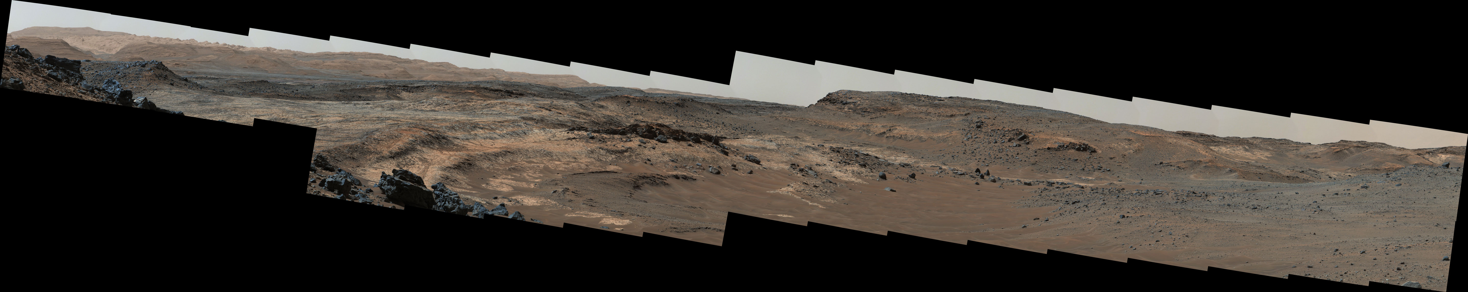 A sweeping panorama combining 33 telephoto images into one Martian vista presents details of several types of terrain visible on Mount Sharp from a location along the route of NASA's Curiosity Mars rover. The component images were taken by the rover's Mast Camera on April 10, 2015.