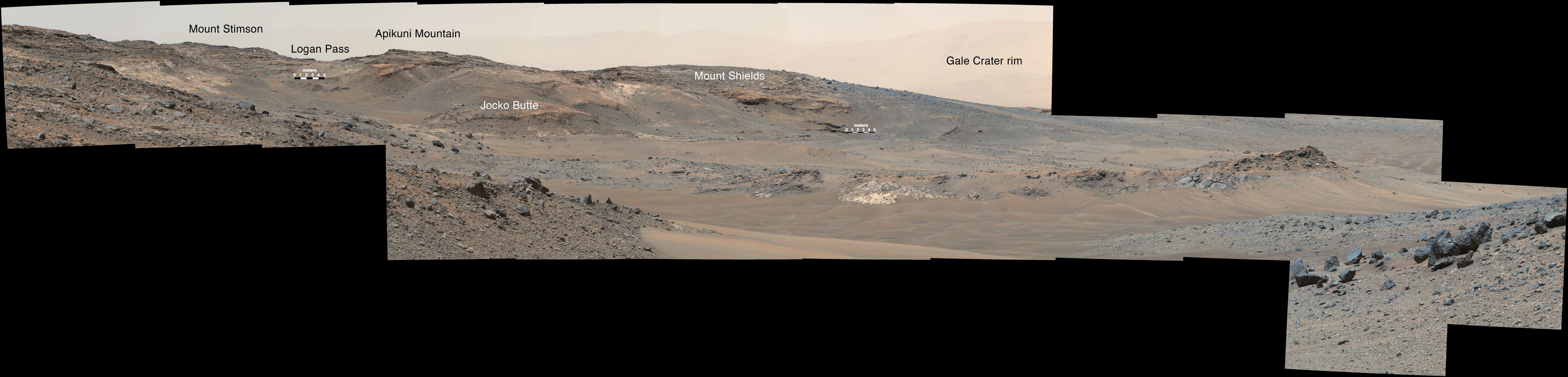 "This April 16, 2015, panorama from the Mast Camera on NASA's Curiosity Mars rover shows a detailed view toward two areas on lower Mount Sharp chosen for close-up inspection in subsequent weeks: ""Mount Shields"" and ""Logan Pass."""