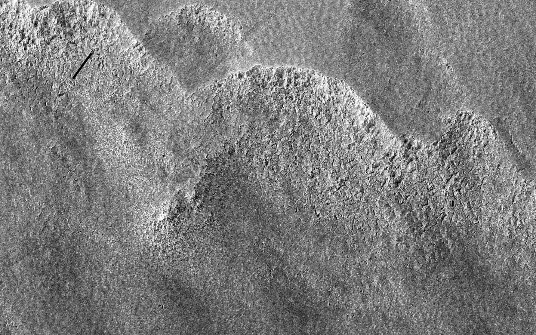 This image is of a portion of the Southern plains region within Hellas, the largest impact basin on Mars, with a diameter of about 2300 kilometers (1400 miles).