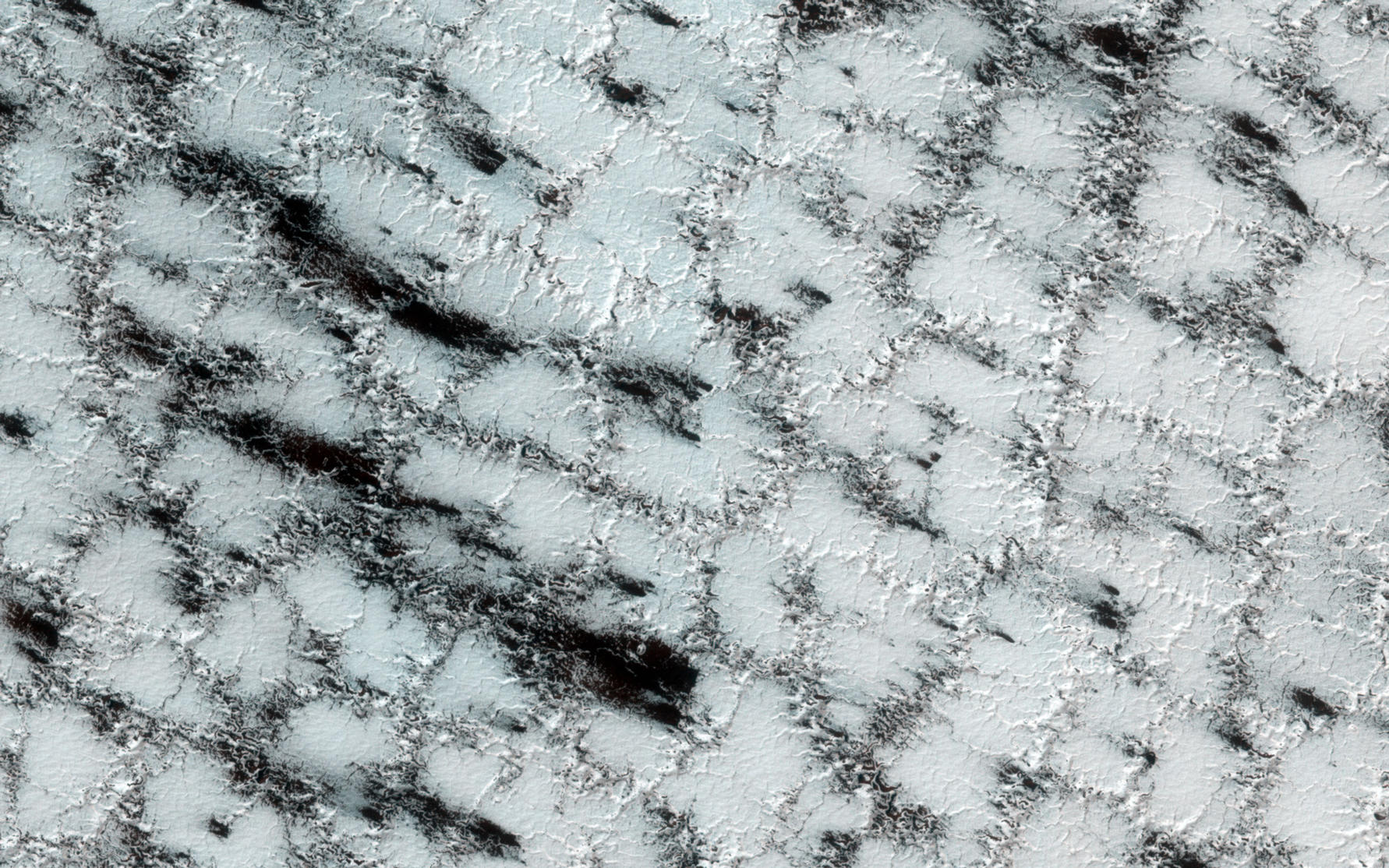 Although the season is late spring, carbon dioxide ice still covers much of the surface at this high latitude site.