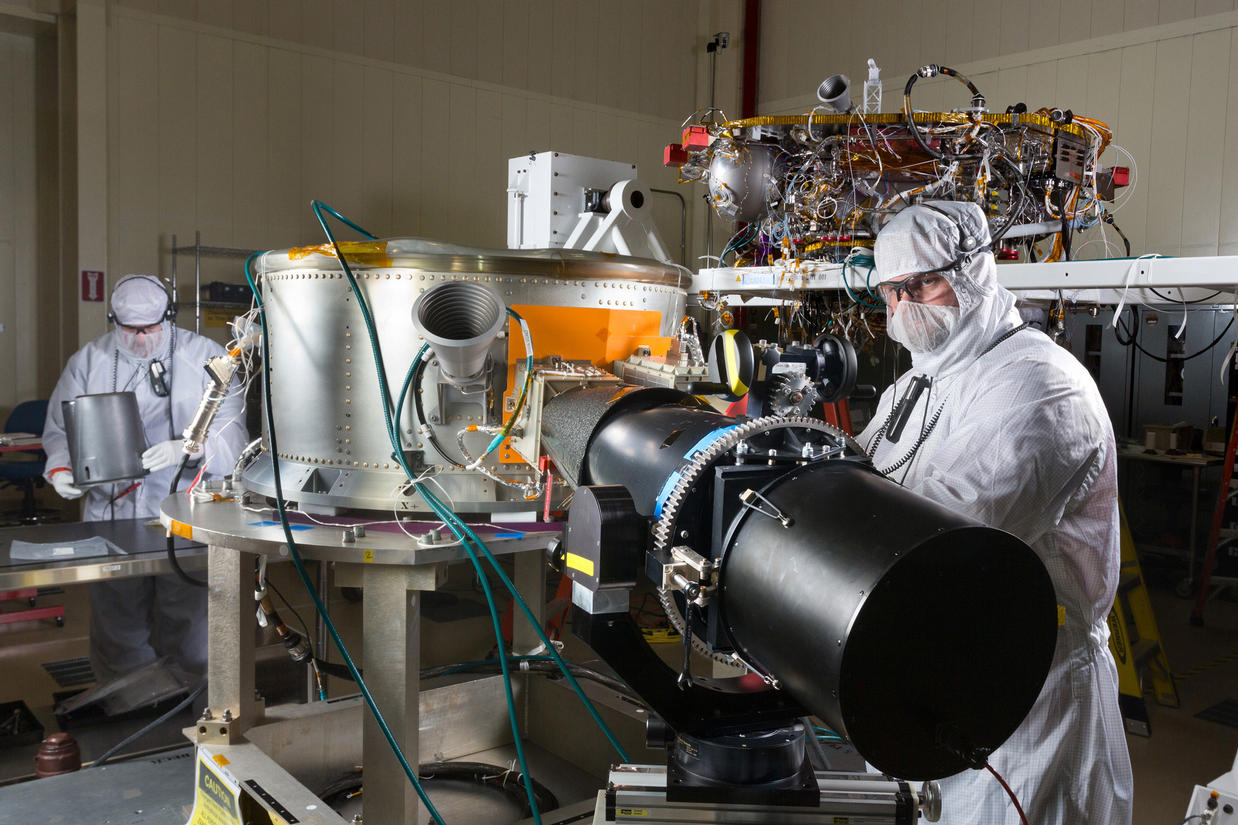 Spacecraft specialists in a clean room at Lockheed Martin Space Systems, Denver, are working on NASA's InSight spacecraft in this January 2015 scene from the mission's assembly and testing phase.