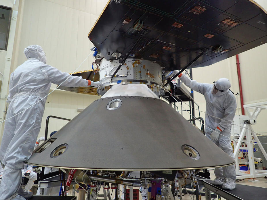 Spacecraft specialists at Lockheed Martin Space Systems, Denver, are preparing to attach the cruise stage of NASA's InSight spacecraft to the top of the spacecraft's back shell in this April 29, 2015, photo.