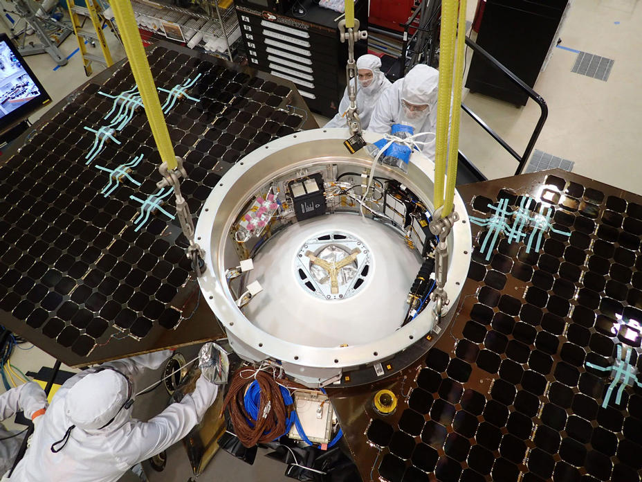 This photo shows the upper side of the cruise stage of NASA's InSight spacecraft as specialists at Lockheed Martin Space Systems, Denver, attach it to the spacecraft's back shell.