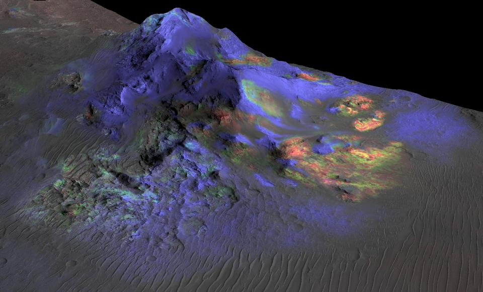 Colorful image showing impact glass distribution on a Martian crater.  These glass deposits are scattered with areas of green showing more glass versus other areas in blue.