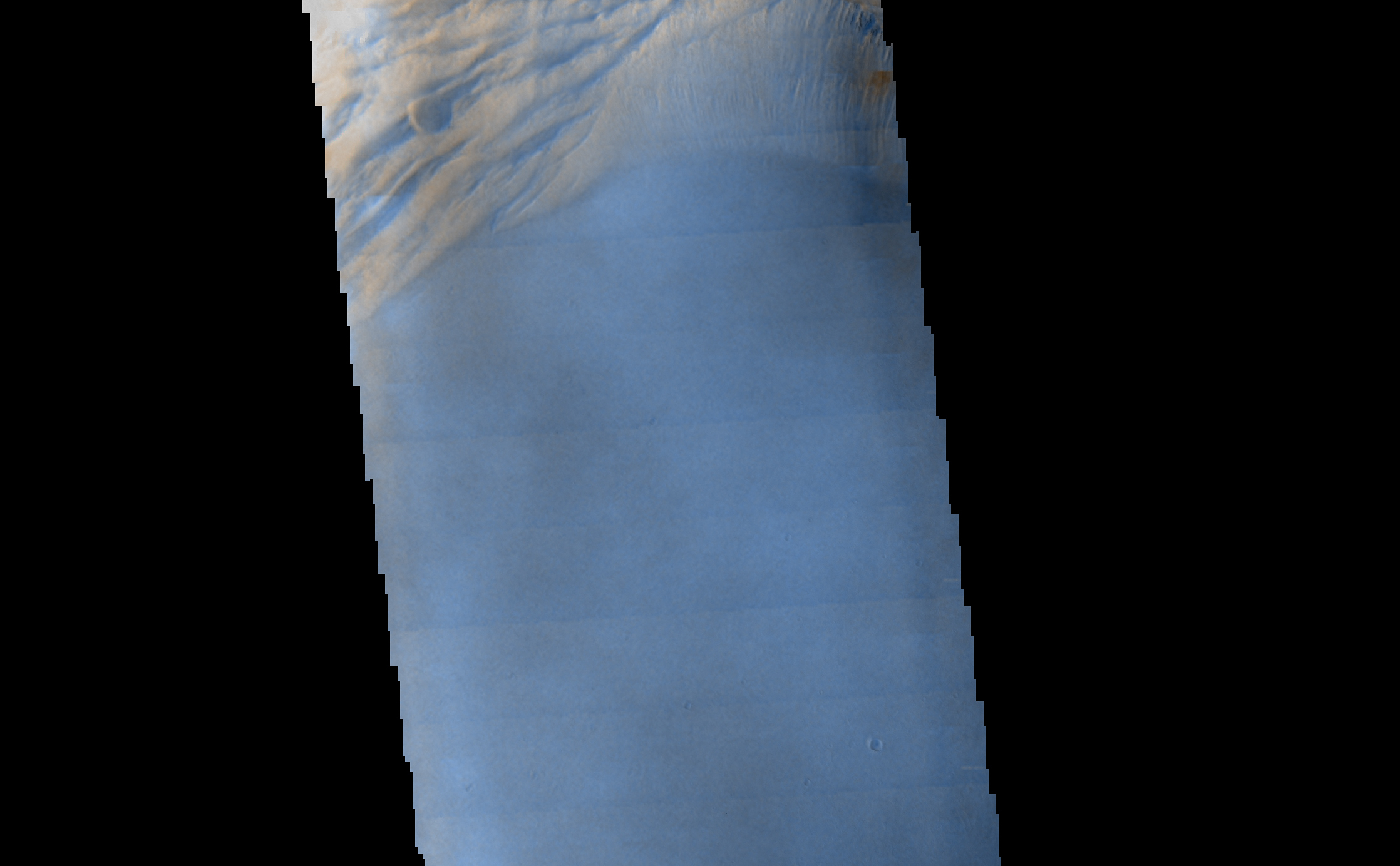 Seen shortly after local Martian sunrise, clouds gather in the summit pit, or caldera, of Arsia Mons, a giant volcano on Mars, in this image from the Thermal Emission Imaging System (THEMIS) on NASA's Mars Odyssey orbiter.