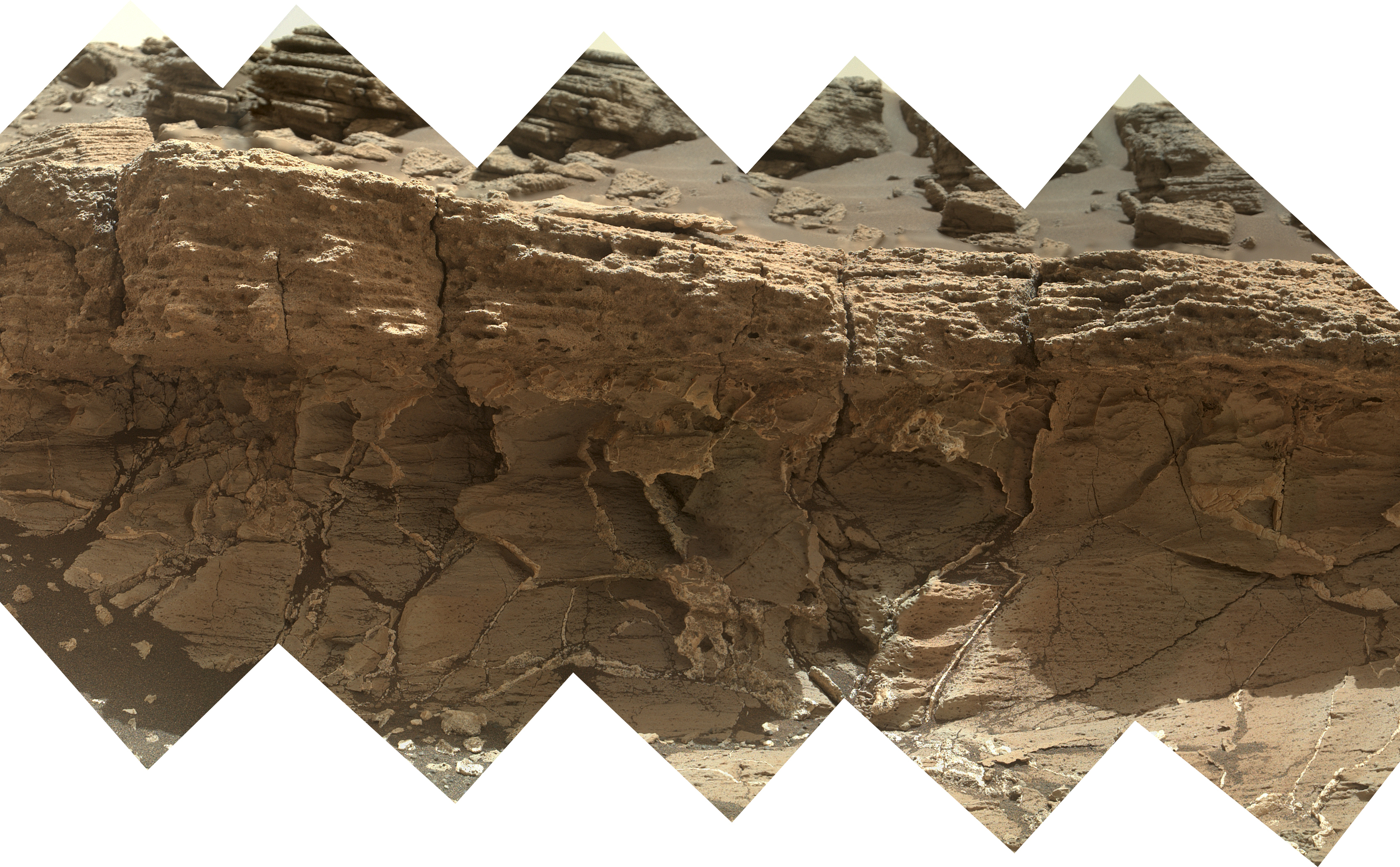 "A rock outcrop dubbed ""Missoula,"" near Marias Pass on Mars, is seen in this image mosaic taken by the Mars Hand Lens Imager on NASA's Curiosity rover."