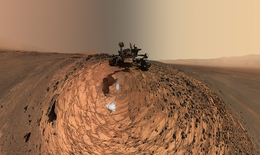 "This low-angle self-portrait of NASA's Curiosity Mars rover from Aug. 5, 2015, shows the vehicle above the ""Buckskin"" rock target in the ""Marias Pass"" area of lower Mount Sharp. The MAHLI camera on Curiosity's robotic arm took dozens of images that were stitched together into this sweeping panorama."