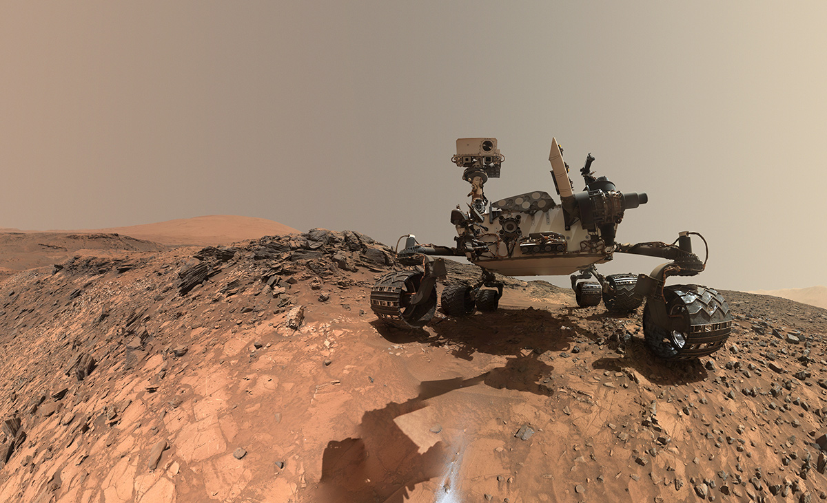 "This low-angle self-portrait of NASA's Curiosity Mars rover shows the vehicle at the site from which it reached down to drill into a rock target called ""Buckskin."" Bright powder from that July 30, 2015, drilling is visible in the foreground."