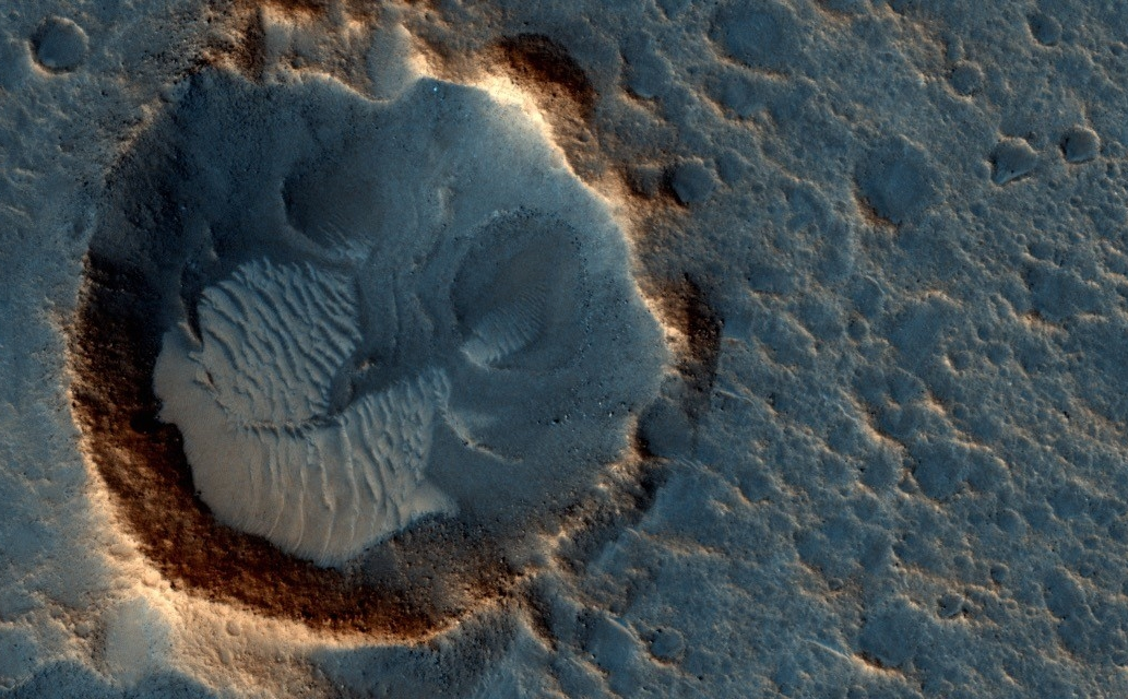"This May 2015 image from the HiRISE camera on NASA's Mars Reconnaissance Orbiter shows a location on Mars associated with the best-selling novel and Hollywood movie, ""The Martian."" It is in a region called Acidalia Planitia, at the landing site for the science-fiction tale's Ares 3 mission."