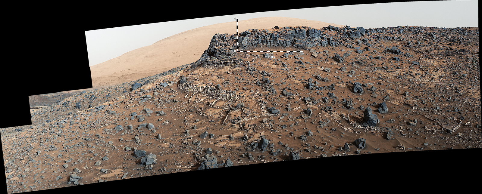 "This March 27, 2015, view from the Mast Camera (Mastcam) on NASA's Curiosity Mars rover shows a site with a network of prominent mineral veins below a cap rock ridge on lower Mount Sharp. At this ""Garden City"" site, the veins have been more resistant to erosion than the surrounding host rock."