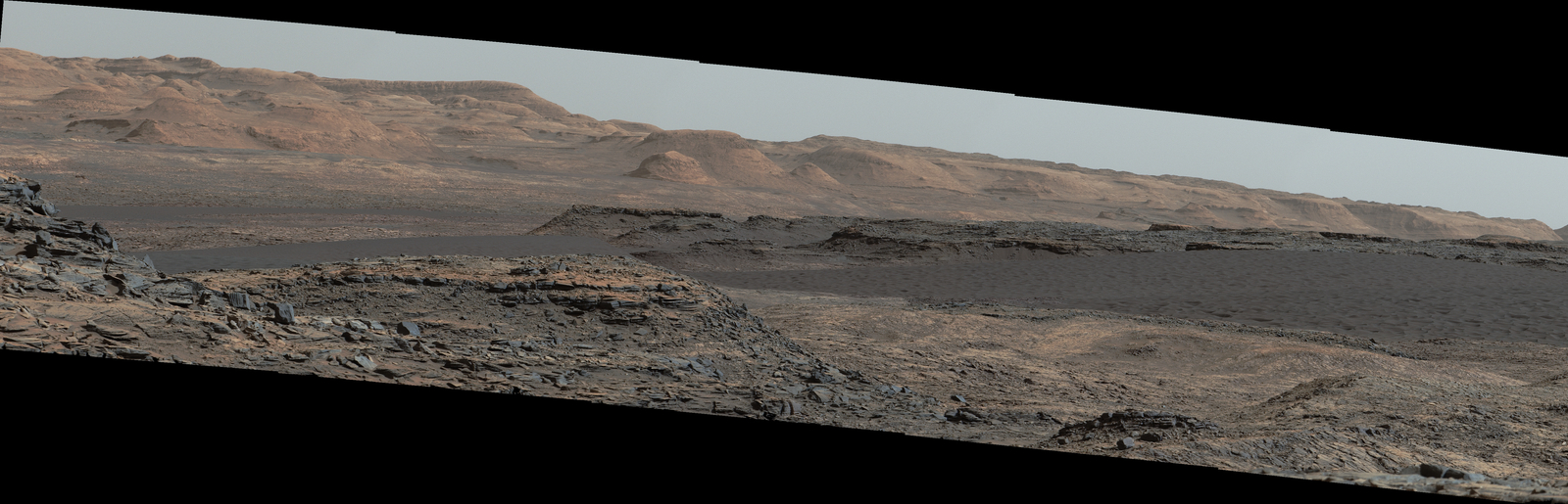 This Sept. 25, 2015, view from the Mast Camera on NASA's Curiosity Mars rover shows a dark sand dune in the middle distance. The rover's examination of dunes on the way toward higher layers of Mount Sharp will be the first in-place study of an active sand dune anywhere other than Earth.