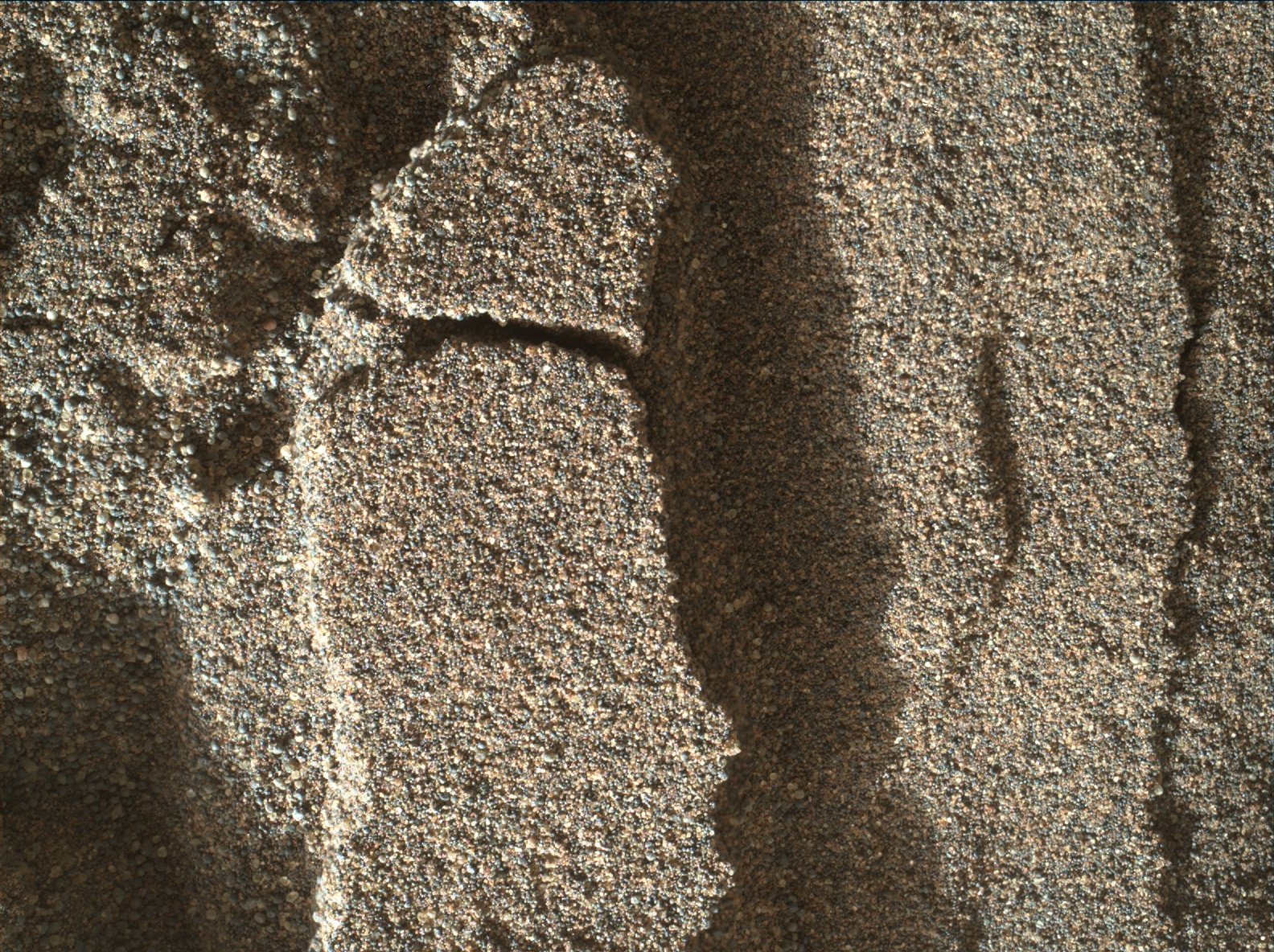 In an up-close 1-inch-wide view, grains of sand near a Martian sand dune are imaged by the arm camera on NASA's Mars rover Curiosity Mars rover.