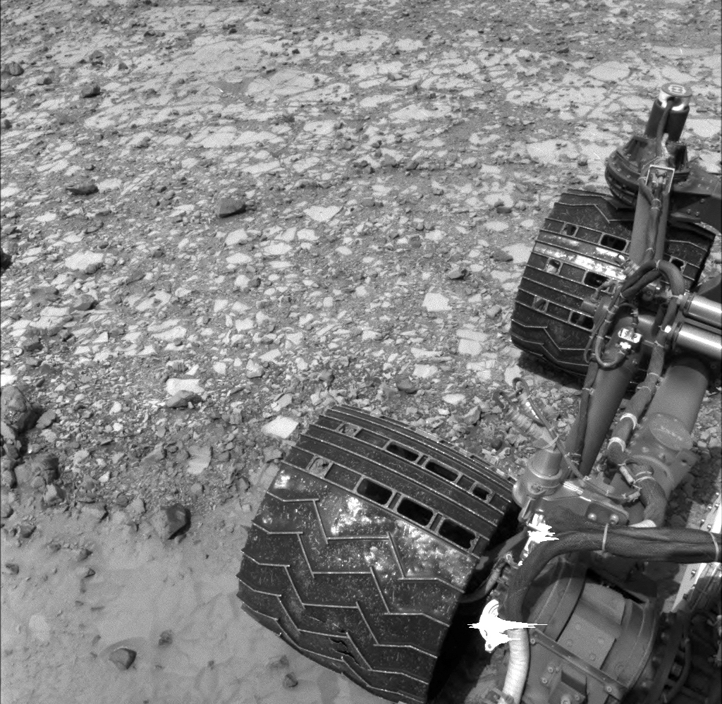 "NASA's Curiosity Mars rover used its Navigation Camera (Navcam) to capture this view partway back down a slope it climbed toward ""Marias Pass"" on lower Mount Sharp."