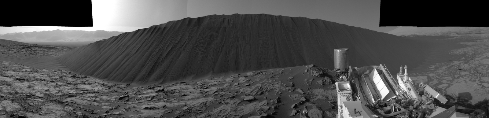 This view from NASA's Curiosity Mars Rover shows the downwind side of a dune about 13 feet high within the Bagnold Dunes field on Mars. The rover's Navigation Camera took the component images on Dec. 17, 2015. As on Earth, the downwind side of an active sand dune has a steep slope called a slip face.