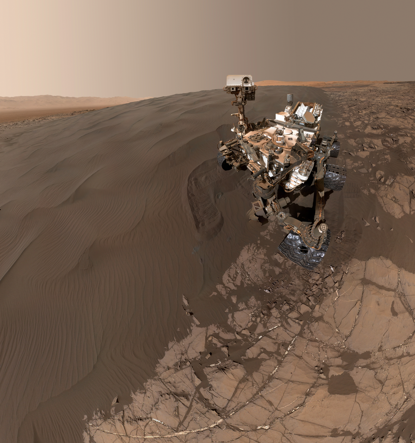 "This Jan. 19, 2016, self-portrait of NASA's Curiosity Mars rover shows the vehicle at ""Namib Dune,"" where the rover's activities included scuffing into the dune with a wheel and scooping samples of sand for laboratory analysis."