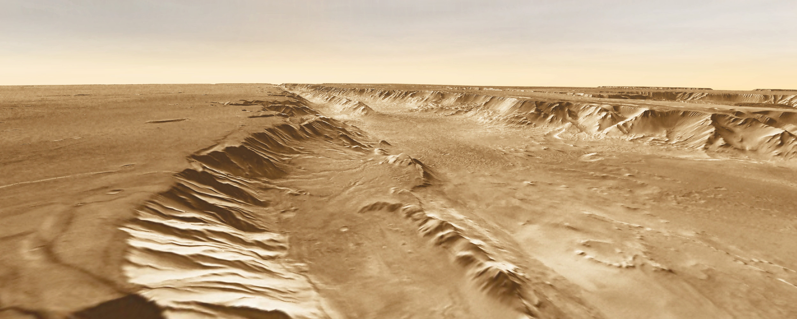 A small basin (center foreground) lies below the southern rim of Melas Chasma, part of Valles Marineris.
