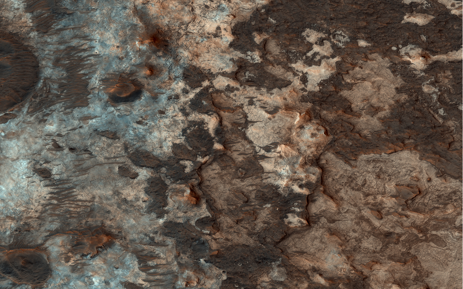 "Mawrth Vallis has a rich mineral diversity, including clay minerals that formed by the chemical alteration of rocks or loose ""regolith"" (soil) by water."