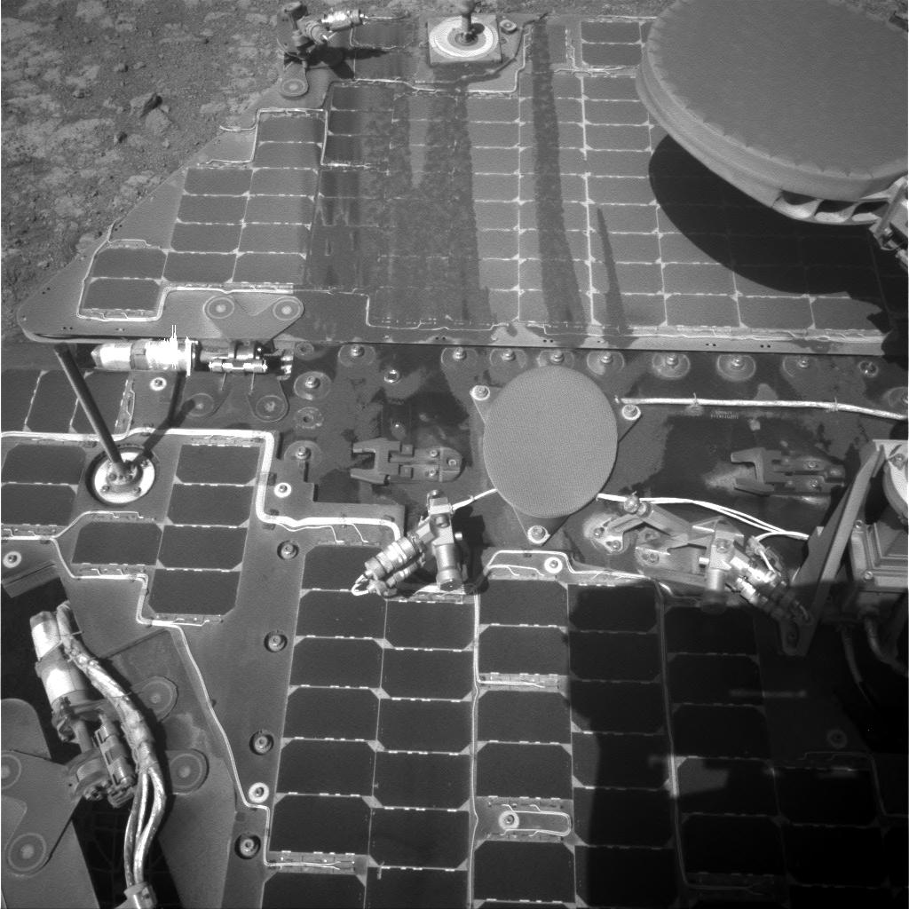 This March 21, 2016, image from the navigation camera on NASA's Mars rover Opportunity shows streaks of dust or sand on the vehicle's rear solar panel after a series of drives during which the rover was pointed steeply uphill. The tilt and jostling of the drives affected material on the rover deck.