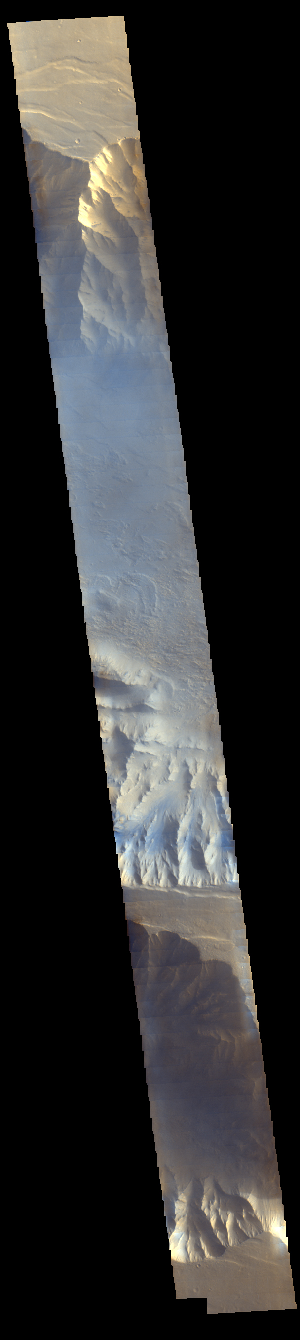 Morning clouds fill Coprates Chasma on Mars in this Nov. 25, 2015, image from the THEMIS camera on NASA's Mars Odyssey. No orbiter systematically observed Mars in morning sunlight before 2015. The clouds appear blue because ice particles in them scatter blue light more strongly than other colors.