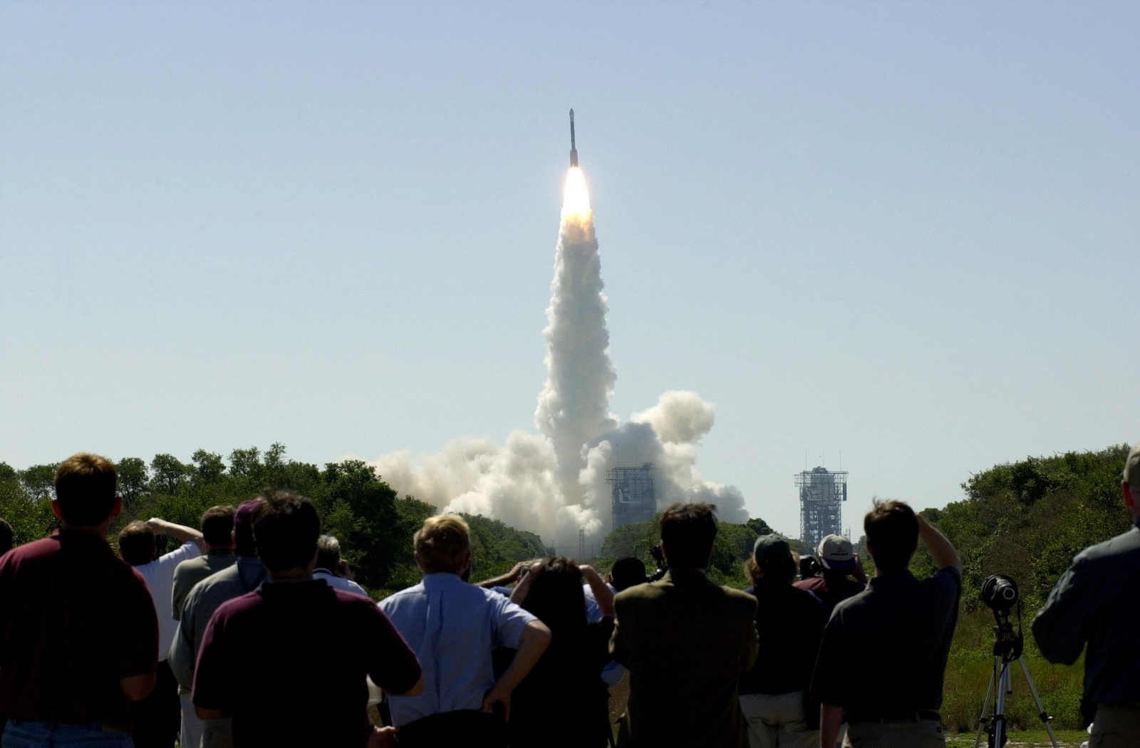 At 11:02 a.m. EDT on April 7, 2001, crowds watch a Boeing Delta II rocket lift off from Cape Canaveral Air Force Station, Florida, carrying NASA's 2001 Mars Odyssey spacecraft into space on its seven-month journey to Mars.