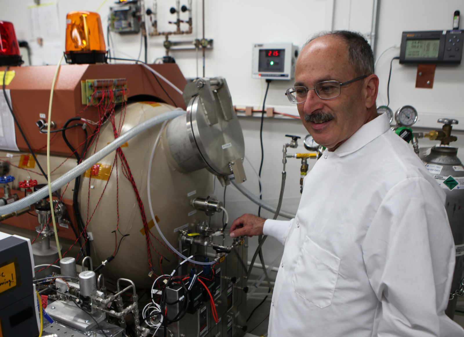 The MOXIE investigation on NASA's Mars 2020 rover will extract oxygen from the Martian atmosphere. In this image, MOXIE Principal Investigator Michael Hecht, of the Massachusetts Institute of Technology, Cambridge, is in the MOXIE laboratory at NASA's Jet Propulsion Laboratory, Pasadena, California.