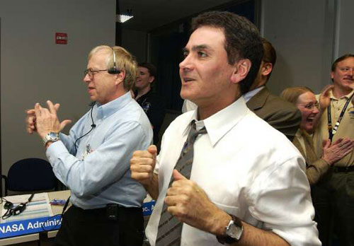 Dr. Ed Weiler, associate administrator, Office of Space Science, NASA Headquarters  and Mars Exploration Program manager, Dr. Firouz Naderi (right) are delighted with the news of Opportunity's safe entry, descent and landing on Mars.
