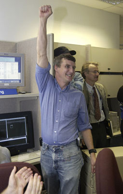 Dr. Steve Squyres, principal investigator for the science instruments 									on both Mars Exploration Rovers, celebrates as the team witnesses the 									first images sent back from Spirit.