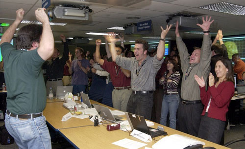 Members of the Mars Exploration Rover Mission's Entry, Descent and 									Landing team rejoice at the news that mission control received its first 									signal from Spirit, indicating the rover's safe arrival at Gusev Crater 									on Mars.