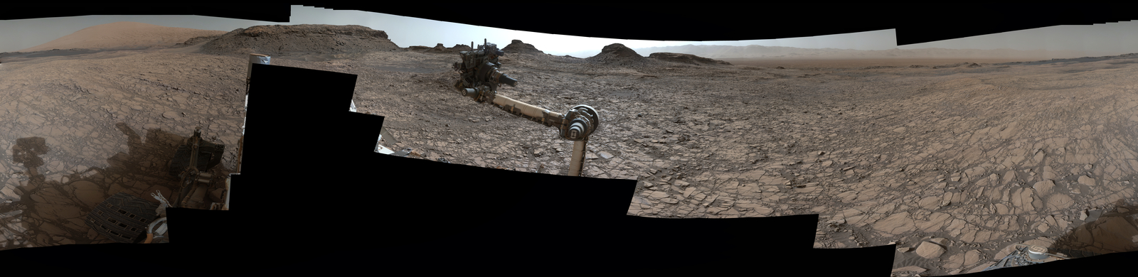 "This 360-degree vista was acquired on Aug. 5, 2016, by the Mastcam on NASA's Curiosity Mars rover as the rover neared features called ""Murray Buttes"" on lower Mount Sharp. The dark, flat-topped mesa seen to the left of the rover's arm is about 50 feet high and, near the top, about 200 feet wide."