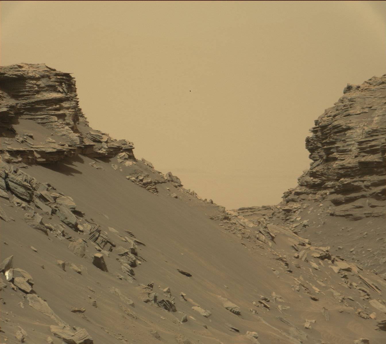 "Curiosity viewed sloping buttes and layered outcrops as it exited the ""Murray Buttes"" region on lower Mount Sharp, Sept. 9, 2016."