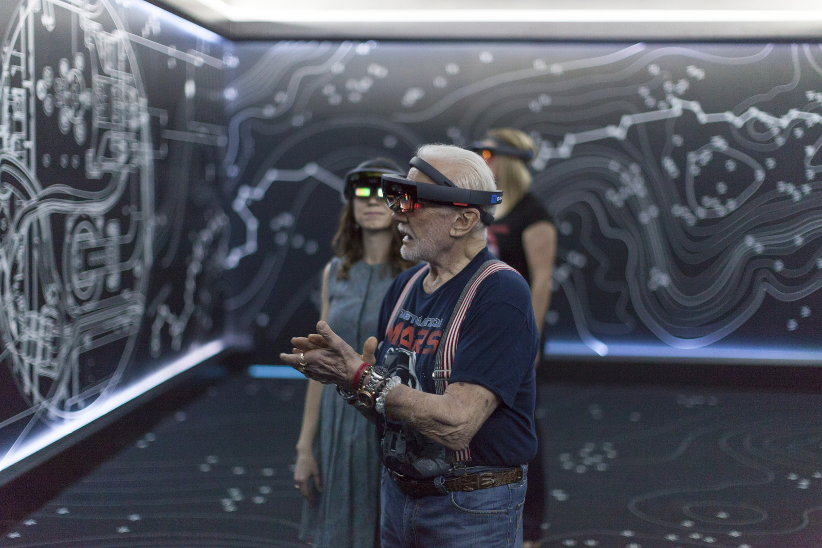 "Apollo 11 astronaut Buzz Aldrin, right, and Erisa Hines of NASA's Jet Propulsion Laboratory in Pasadena, California, try out the Microsoft Hololens mixed reality headset during a preview of ""Destination: Mars"" at Kennedy Space Center visitor complex in Florida."