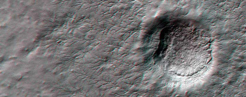 This anaglyph from HiRISE shows erosional features formed by seasonal frost near the south pole of Mars.