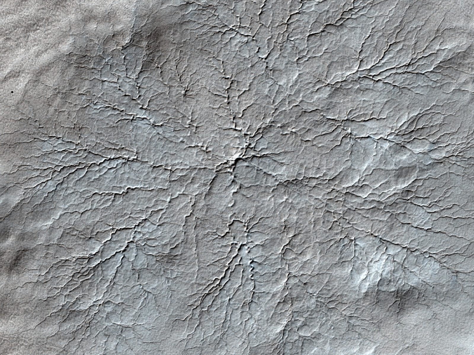This HiRISE image shows erosional features formed by seasonal frost near the south pole of Mars.