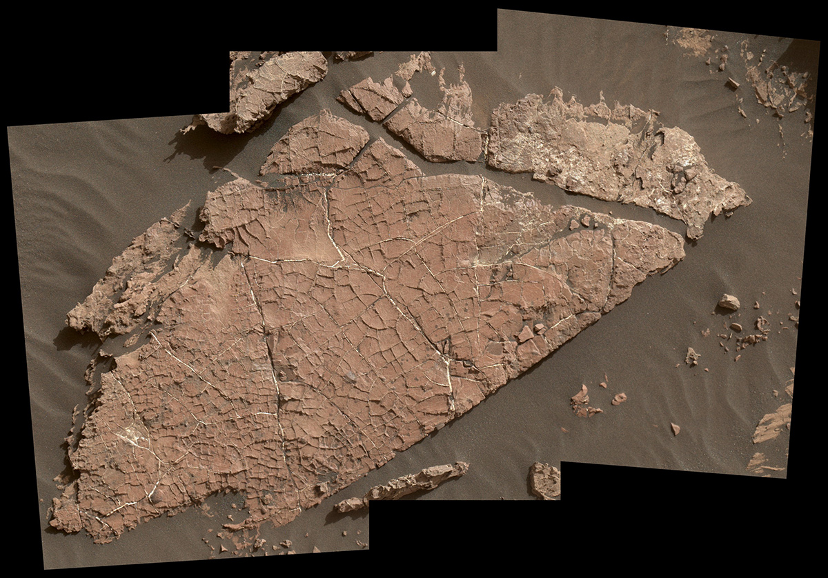 "The network of cracks in this Martian rock slab called ""Old Soaker"" may have formed from the drying of a mud layer more than 3 billion years ago. The view spans about 3 feet (90 centimeters) left-to-right and combines three images taken by the MAHLI camera on the arm of NASA's Curiosity Mars rover."