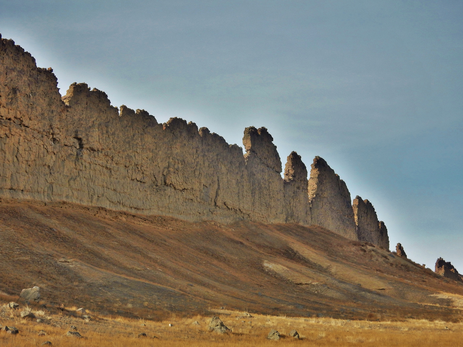 This photograph from Shiprock in northwestern New Mexico shows a ridge roughly 30 feet (about 10 meters) tall that formed from lava filling an underground fracture then resisting erosion better than the material around it did.