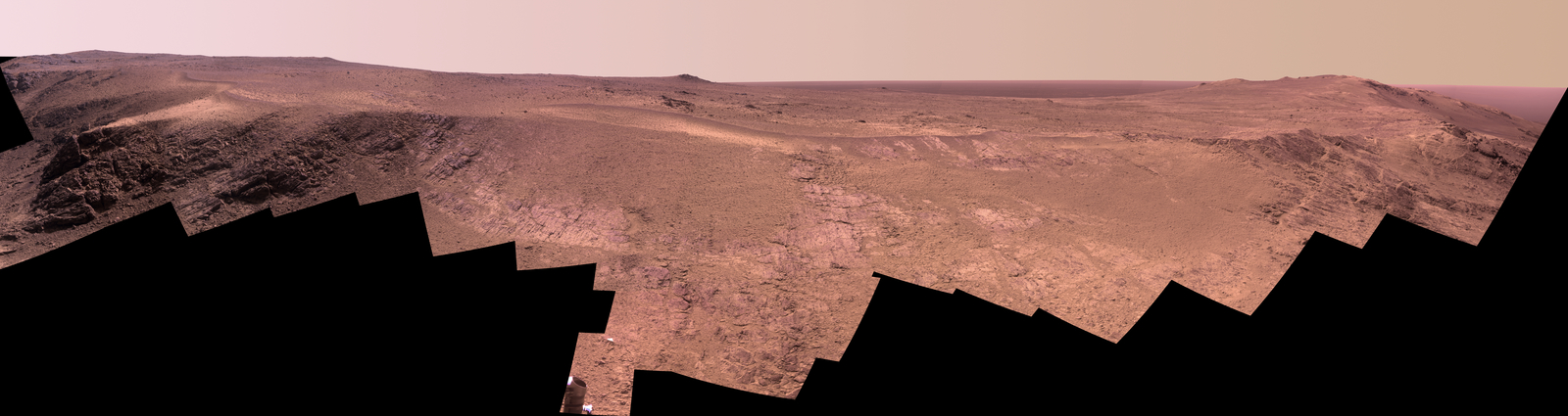"A grooved ridge called ""Rocheport"" on the rim of Mars' Endeavour Crater spans this scene from the Pancam on NASA's Mars rover Opportunity. The view extends from south-southeast on the left to north on the right. The site is near the southern end of an Endeavour rim segment called ""Cape Tribulation."""
