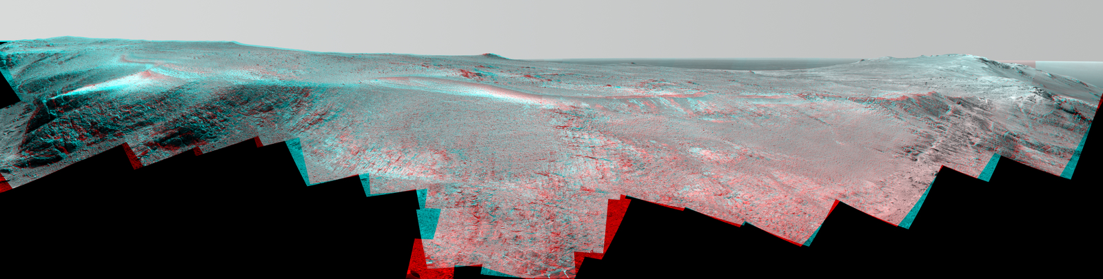 "A grooved ridge called ""Rocheport"" on the rim of Mars' Endeavour Crater spans this stereo scene from NASA's Mars rover Opportunity. The view combines images from left eye and right eye of the rover's Pancam to appear three-dimensional when seen through blue-red glasses with the red lens on the left."