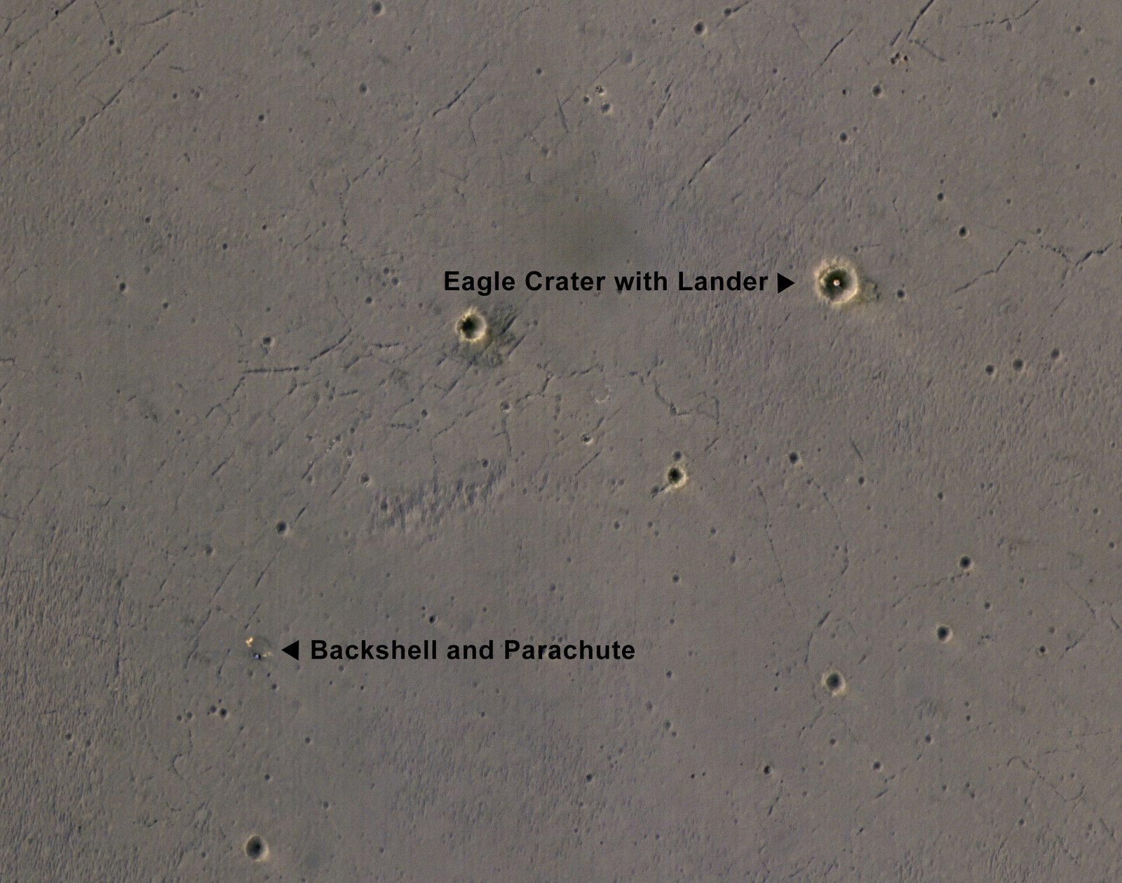 "The bright landing  platform left behind by NASA's Mars Exploration Rover Opportunity in 2004 is  visible inside Eagle Crater, where ""Opportunity Lander"" is indicated  in this annotated, April 8, 2017, image from NASA's Mars Reconnaissance  Orbiter."