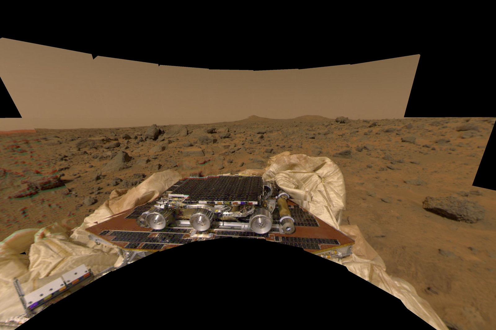 This image features a different perspective of one of the first pictures taken by the Imager for Mars Pathfinder (IMP) lander shortly after its touchdown at 10:07 AM Pacific Daylight Time on July 4. Sol 1 began on July 4, 1997.